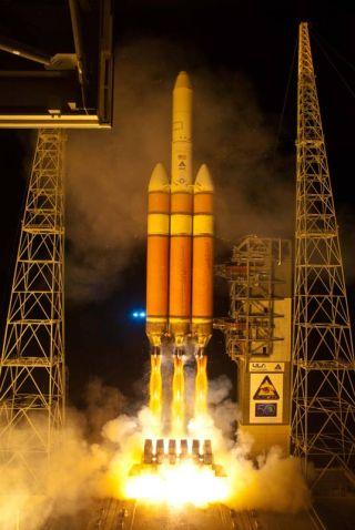 Secret U.S. Spy Satellite Launches Into Orbit on Huge Rocket