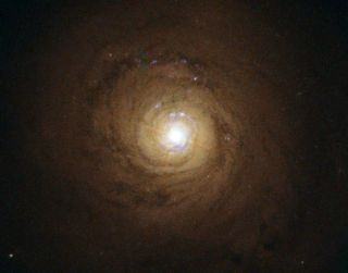 The supermassive black hole at the center of NGC 5548 behaves strangely. The galaxy is about 245 million light-years from Earth.