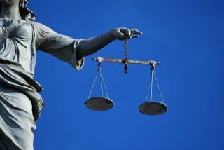 Lady Justice holding the scales of justice.