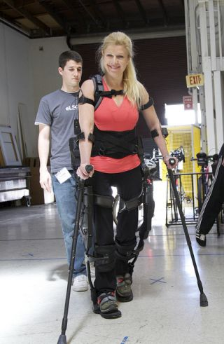 Photo of an Ekso Bionics employee wearing the robotic suit