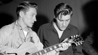 Elvis Presley and Scotty Moore rehearse for their appearance on the Milton Berle Show at the NBC Burbank studios on June 4 1956 in Los Angeles California