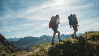 Two people liking across a ridge