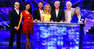 We've never seen anybody take this show quite as seriously as Karen Clifton – woe betide her husband and fellow Strictly pro dancer Kevin if he gets any answers wrong!