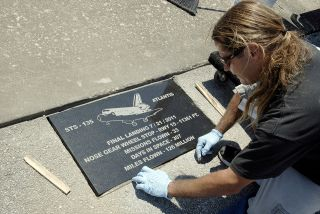 The stopping point of NASA's last space shuttle mission STS-135 aboard Atlantis is commemorated with a plaque.