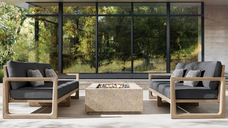 A set of teak wood outdoor sofas with grey upholstery