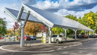 An electric car charging station with a solar roof