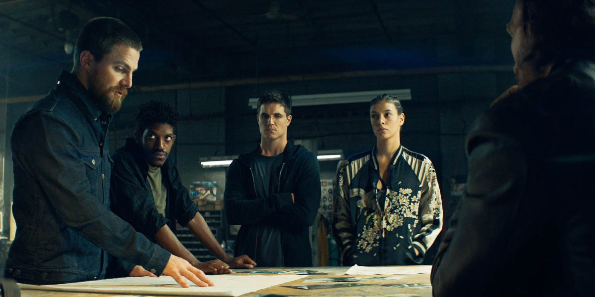 Code 8 the crew stands around the plans