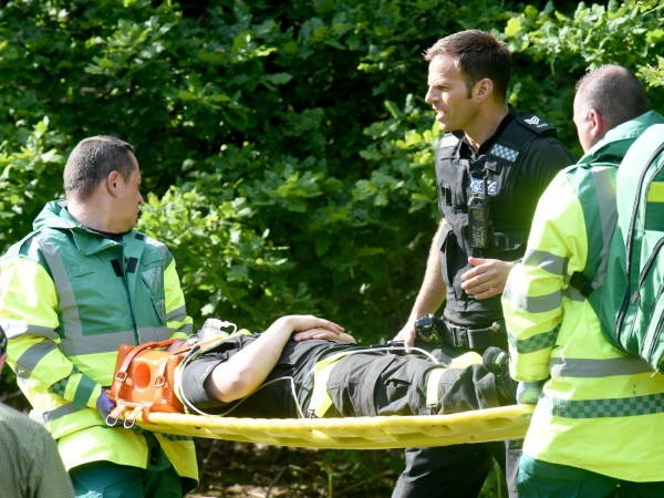 Jason Roscoe being taken to hospital after his fall