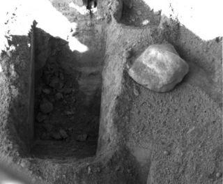 Mars Lander Digs Deeper Into Mars