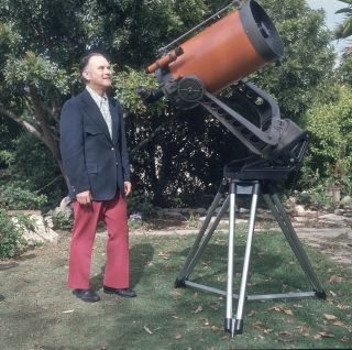 Celestron founder Tom Johnson poses with a Celestron telescope. The technology of amateur telescopes has made huge strides over the last 60 years.