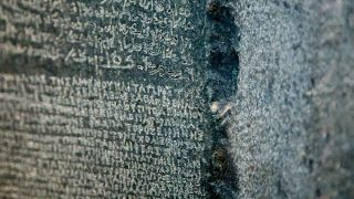 Rosetta stone - A basalt tablet bearing nscriptions in Greek, Egyptian and demotic scripts.
