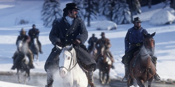Cowboys ride through the snow in Red Dead Redemption 2.