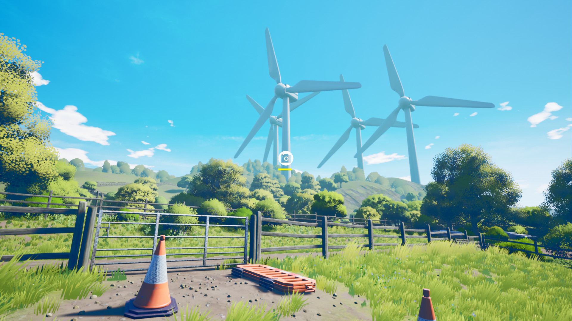 An english field watched over by wind turbines