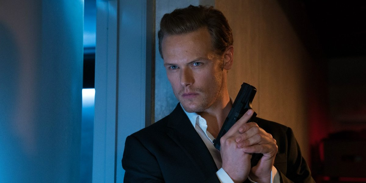Sam Heughan sneaking around with a gun in The Spy Who Dumped Me.