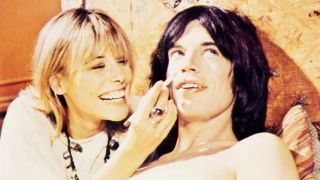 Anita Pallenberg and Mick Jagger in 1970 film Performance