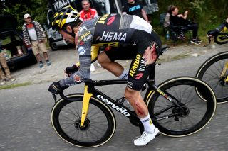 Primoz Roglic chasing after his stage 3 crash at the Tour de France