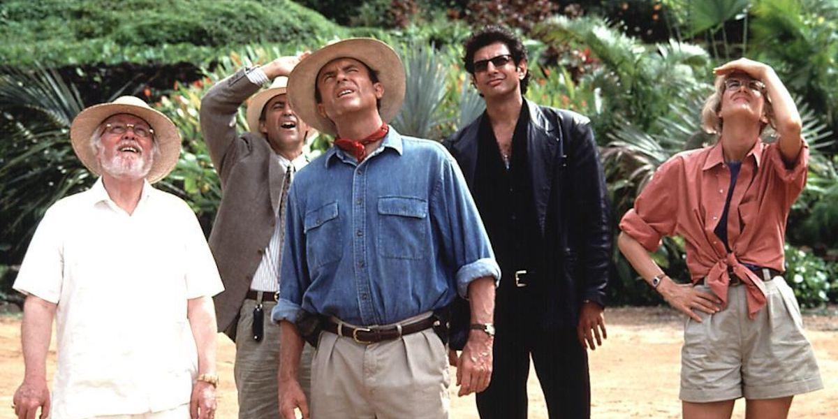 John Hammond, Alan Grant, Ian Malcolm and Ellie Sattler look up at an off-screen dinosaur in 'Jurassic Park'
