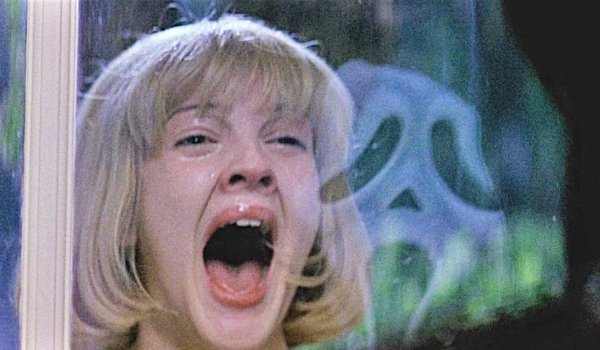 Scream Drew Barrymore is frightened by Ghostface in the glass