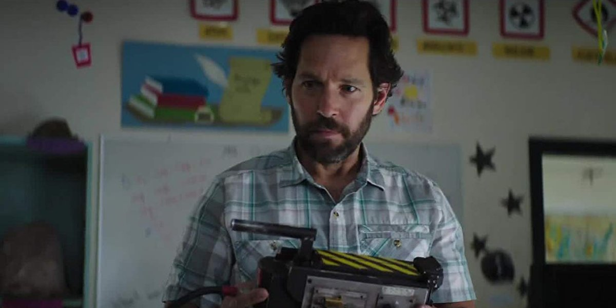 Ghostbusters Afterlife Paul Rudd holds a ghost trap curiously