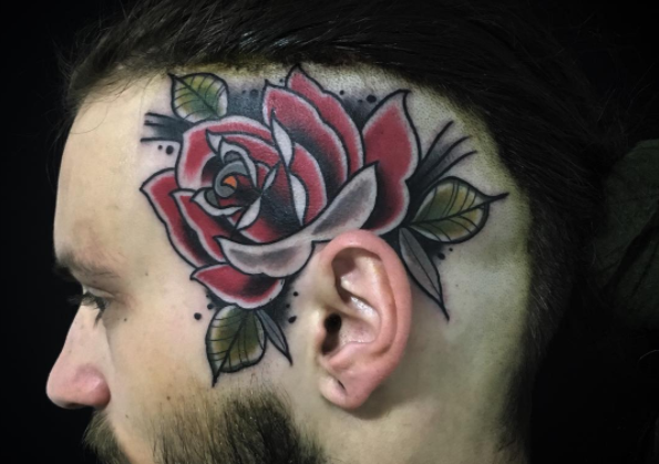 red rose tattoo on head