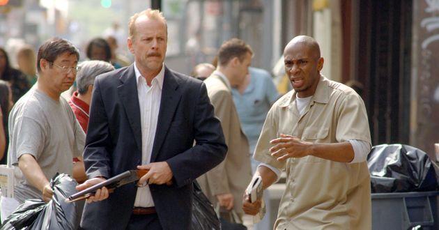 BRUCE WILLIS as Jack Mosley and MOS DEF as Eddie Bunker