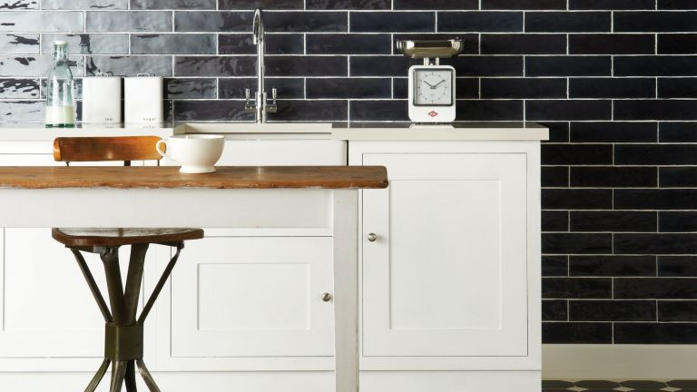 kitchen with monochrome scheme, white cupboards and black metro tiles