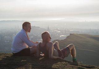 Ewan McGregor and Ewan Bremner set on a hill above Edinburgh admiring the view