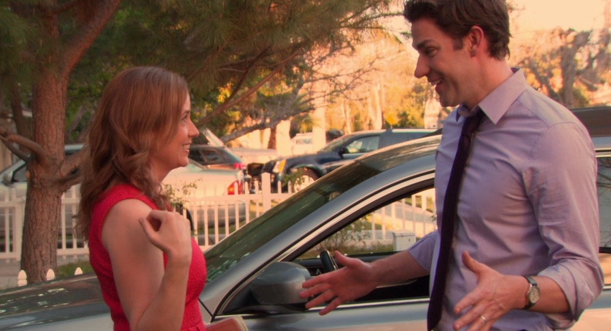 Jim and Pam smiling at each other in The Office finale.