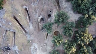 A bird's-eye view showing the two newly discovered tombs on the eastern side of the Mycenaean cemetery at Aidonia, next to tombs from a previous excavation.