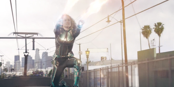 Captain Marvel using her photon blasts atop a moving train