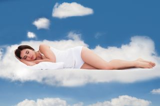 A woman sleeps on a cloud