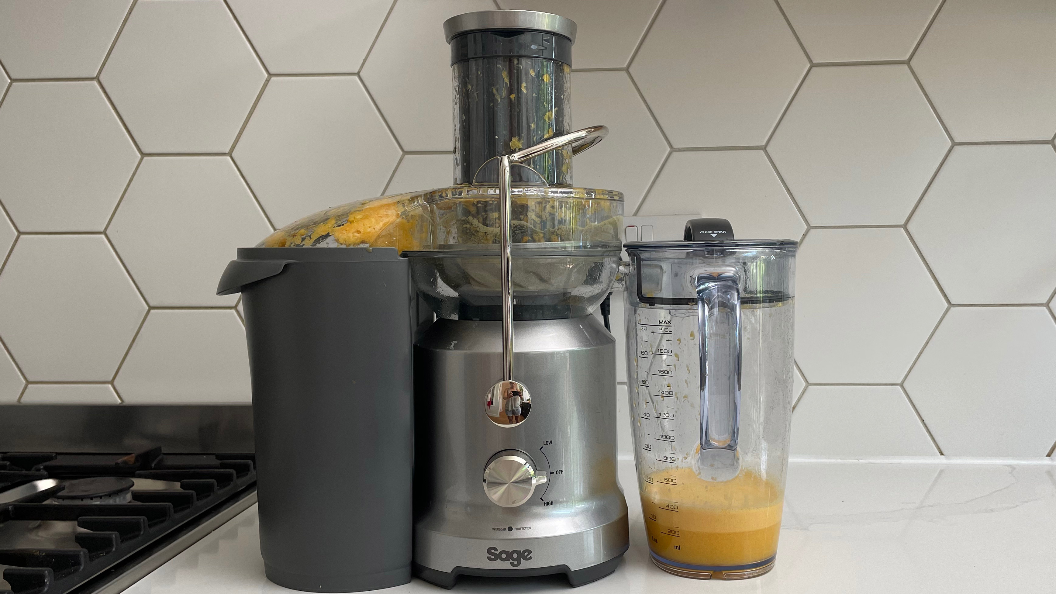 Breville the Juice Fountain Cold on a kitchen countertop filled with orange juice