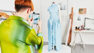 Richard Malone, the designer of the 5G augmented reality dress, interacting with their creation.