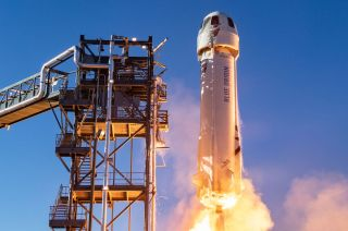 Blue Origin's New Shepard launch vehicle lifts from the company's West Texas launch site on a suborbital test flight. Blue Origin has set July 20 for its first crewed flight, including founder Jeff Bezos and the auction winner who placed a $28 million bid.