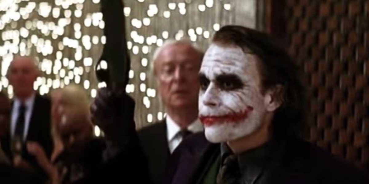 Michael Caine and Heath Ledger in The Dark Knight