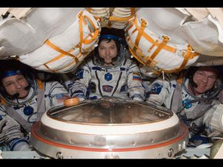 Three space station astronauts are scheduled to return to Earth on July 1, 2012.