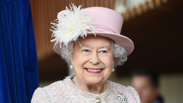 Queen Elizabeth II is seen at the Chichester Theatre while visiting West Sussex on November 30, 2017 in Chichester, United Kingdom.