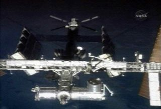 Shuttle Discovery Undocks From Space Station