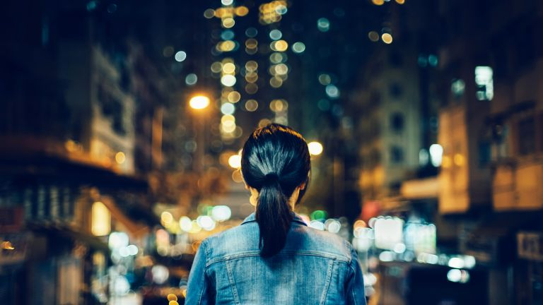 woman alone in city