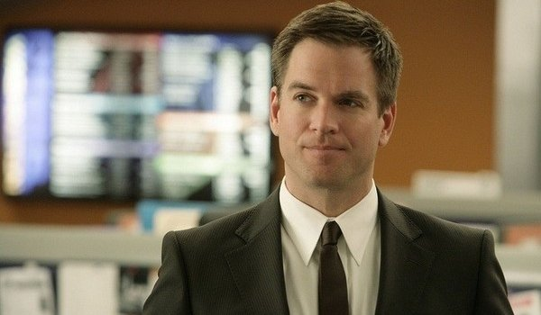 NCIS Tony standing in the office with his trademark smirk