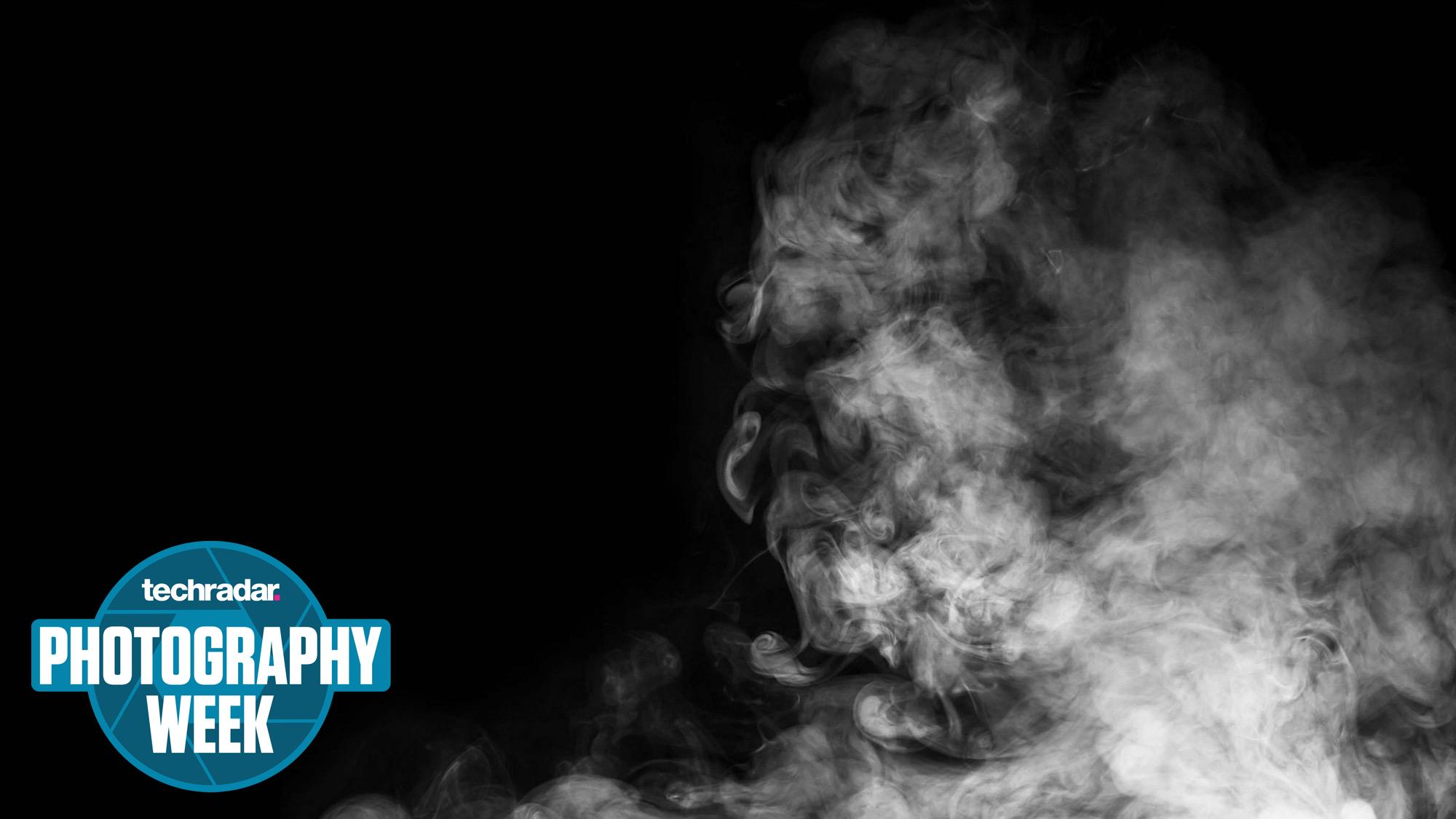 Smoke rising on a black background