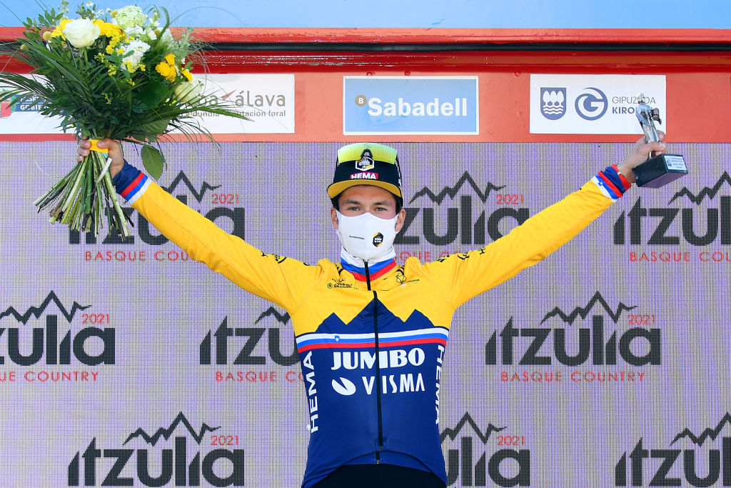 BILBAO SPAIN APRIL 05 Podium Primoz Roglic of Slovenia and Team Jumbo Visma Celebration during the 60th ItzuliaVuelta Ciclista Pais Vasco 2021 Stage 1 a 139km individual time trial from Bilbao to Bilbao Mask Covid safety measures Trophy Flowers itzulia ehitzulia ITT on April 05 2021 in Bilbao Spain Photo by David RamosGetty Images