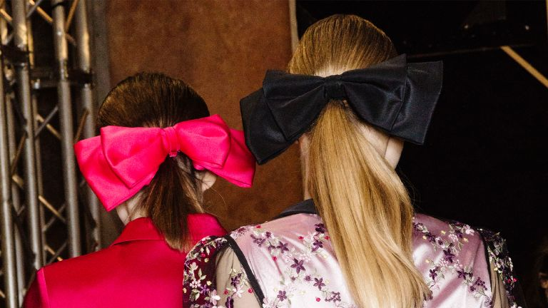 MILAN, ITALY - FEBRUARY 25: Models, hair detail, are seen backstage ahead of the Piccione.Piccione show during Milan Fashion Week Fall/Winter 2018/19 on February 25, 2018 in Milan, Italy. (Photo by Rosdiana Ciaravolo/Getty Images)