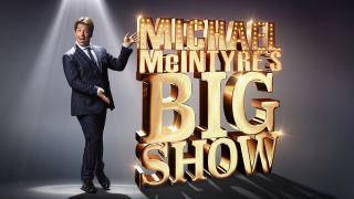 Michael McIntyre pointing to a sign saying Michael McIntyre's Big Show
