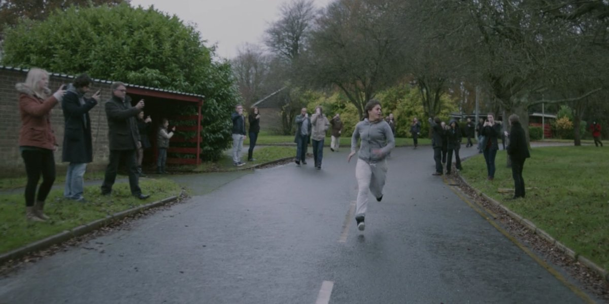 Lenora Crichlow running away from cellphone zombies in Black Mirror Season 2