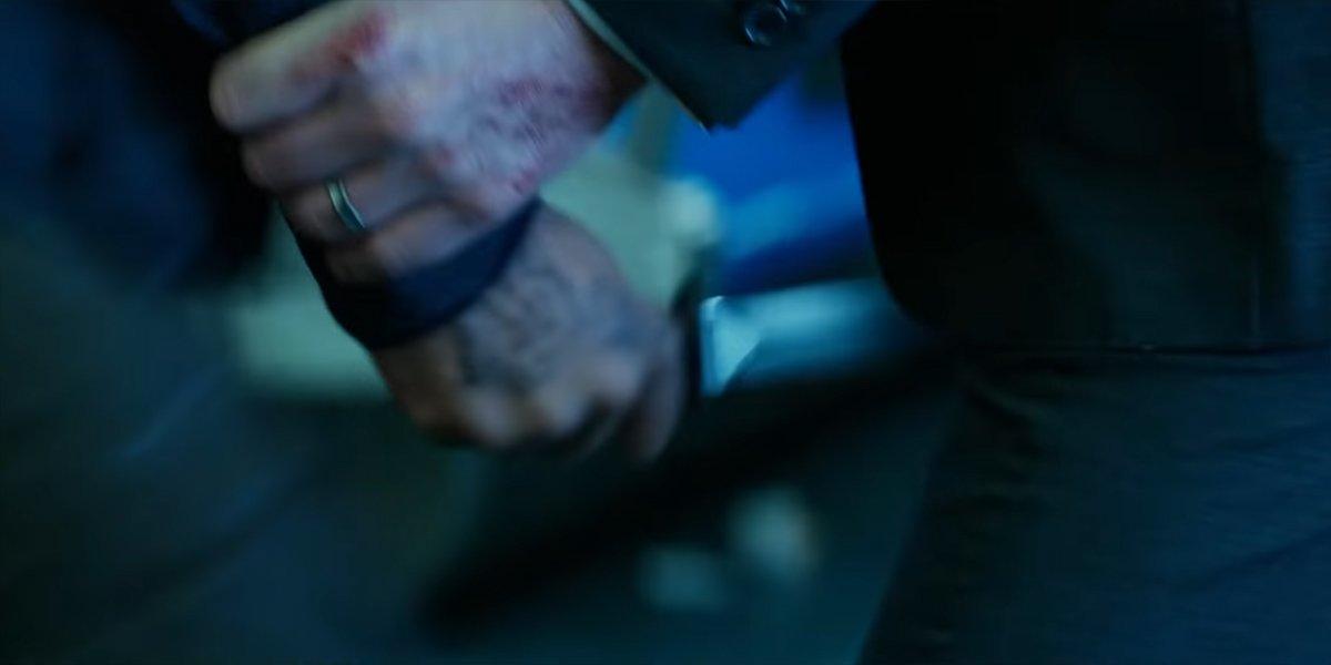 John Wick stabbed in the leg