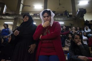Egyptian Coptic Christians gather for a Christmas Eve mass in a chapel at the St. Saman Monastery in Cairo, Egypt, on Jan. 6, 2014.
