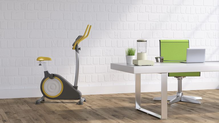 best elliptical trainers on display in home near computer