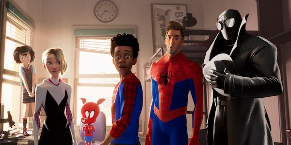 Spider-Man: Into The Spidervers Miles Morales standing in his dorm room with several other spider pe