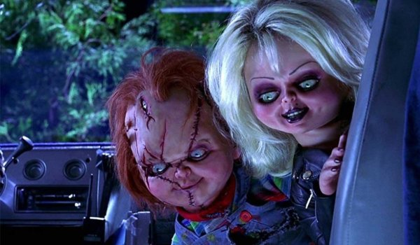 Bride of Chucky Tiffany and Chucky look in on their victim in the van